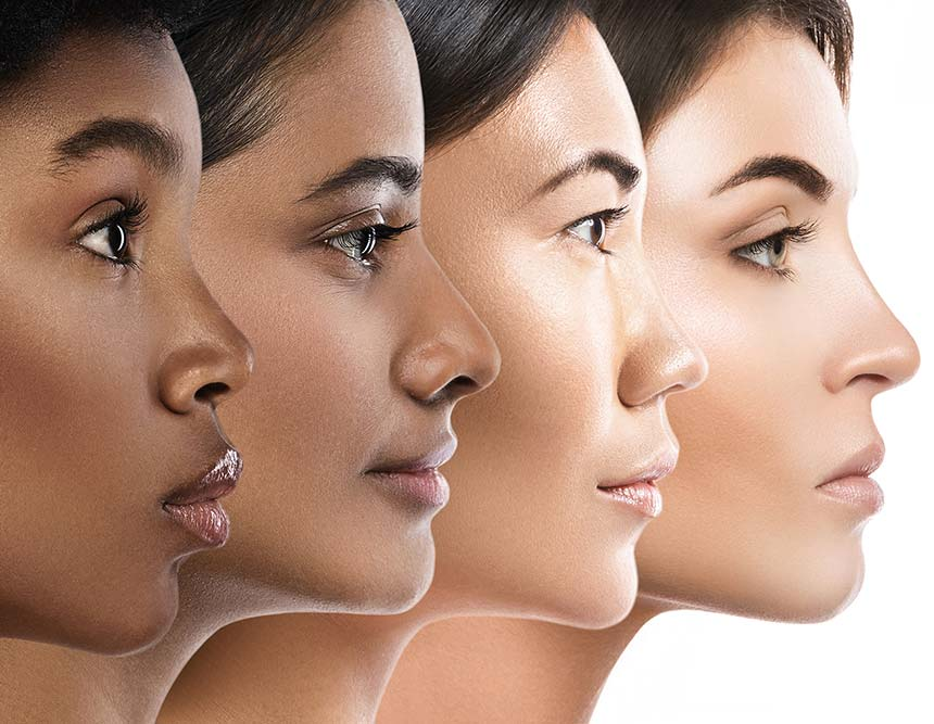 Faces of four woman from different ethnic backgrounds shown in a profile view.