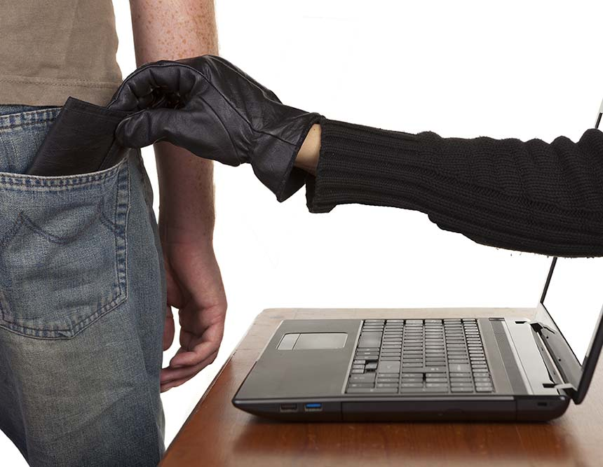 A gloved hand reaches out of a laptop screen and steals a wallet from the back pocket of a man's trousers.
